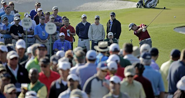 Louis Oosthuizen, of South Africa, tees off on the third hole during the second round of the Masters golf tournament Friday, April 11, 2014, in Augusta, Ga. (AP Photo/David J. Phillip)