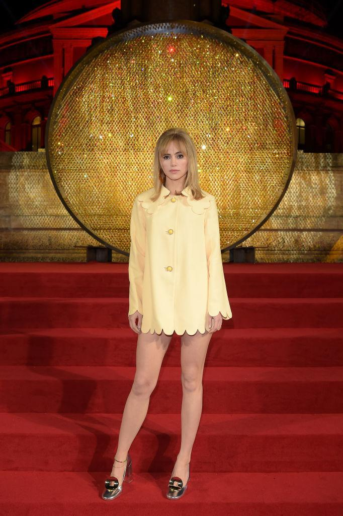 <p>Suki Waterhouse channelled the sixties in a scallop-edged mini dress and jazzy footwear. <em>[Photo: Getty]</em> </p>