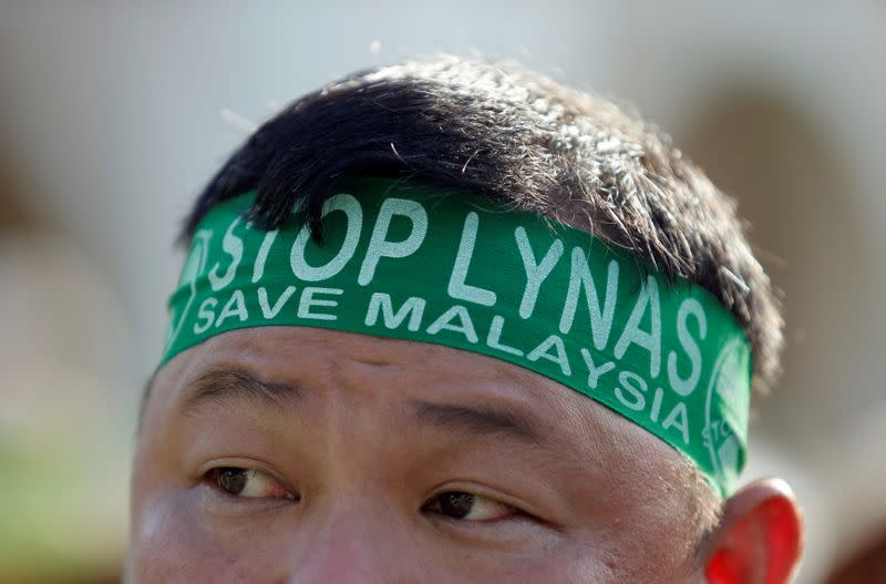 FILE PHOTO: FILE PHOTO: An activist wears a headband during a protest against Australia's Lynas Corp rare earths plant during a rally in Kuala Lumpur, Malaysia