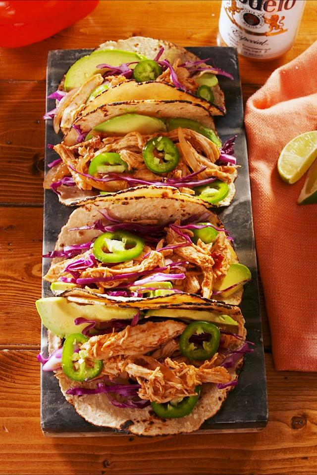 "<p>Make these ASAP; there are a few secret ingredients here that really taken these up a notch.</p><p>Get the recipe from <a href=""https://www.delish.com/cooking/recipe-ideas/a25473302/crockpot-chicken-taco-recipe/"" target=""_blank"">Delish. </a></p>"