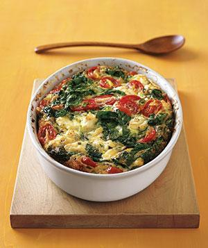 <p>It takes just 10 minutes to assemble this tasty frittata—and the red and green of tomatoes and spinach make it a healthy (and very Christmassy) treat. </p>
