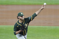 Oakland Athletics starting pitcher Cole Irvin throws in the first inning against the Texas Rangers in a baseball game Tuesday, June 22, 2021, in Arlington, Texas. (AP Photo/Louis DeLuca)