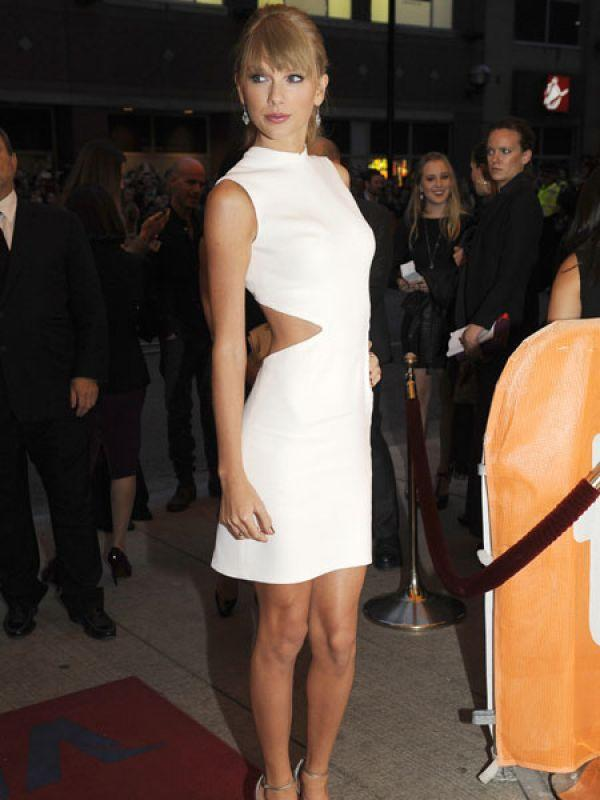 """<p><strong>Image courtesy : iDiva.com</strong></p><p><strong>Taylor Swift</strong>: The pretty singer wore a crisp white short dress with midriff cutouts. If you're digging this dress, you may find something similar at Forever 21 for much cheaper. You're welcome. :)<br /><br /><strong>Celeb Style: <a href=""""http://idiva.com/photogallery-style-beauty/celeb-style-at-toronto-international-film-festival-2013/24202"""" target=""""_blank"""">At Toronto International Film Festival 2013</a></strong></p><p><strong>Related Articles - </strong></p><p><a href='http://idiva.com/photogallery-style-beauty/celeb-trend-of-the-colour-blue-nude-heels/16925' target='_blank'>Celeb Trend: Of The Colour Blue and Nude Heels</a></p><p><a href='http://idiva.com/photogallery-style-beauty/vote-sexiest-b-town-actress-in-cobalt-blue/21370' target='_blank'>Vote: Sexiest B-Town Actress in Cobalt Blue</a></p>"""