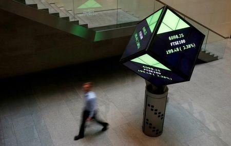 FILE PHOTO:  A man walks through the lobby of the London Stock Exchange in London