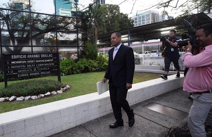 Panamanian Mossack Fonseca lawyer Elias Solano walks outside headquarters of the law firm in Panama City after Public Prosecutor officers inspected site on April 11, 2016 (AFP Photo/Rodrigo Arangua)
