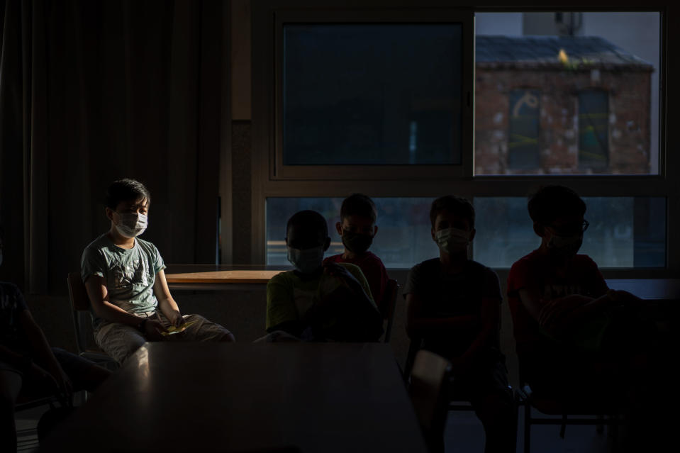 Students wearing face masks to prevent the spread of coronavirus sit in their classroom in a school in Barcelona, Spain, Monday, Sept. 14, 2020. (AP Photo/Emilio Morenatti)