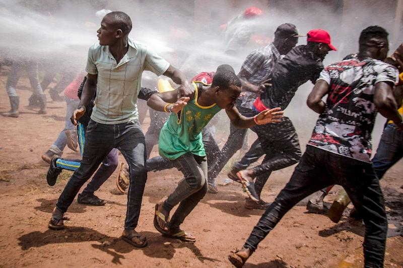 Supporters of Bobi Wine have clashed with police (AFP Photo/Badru KATUMBA)