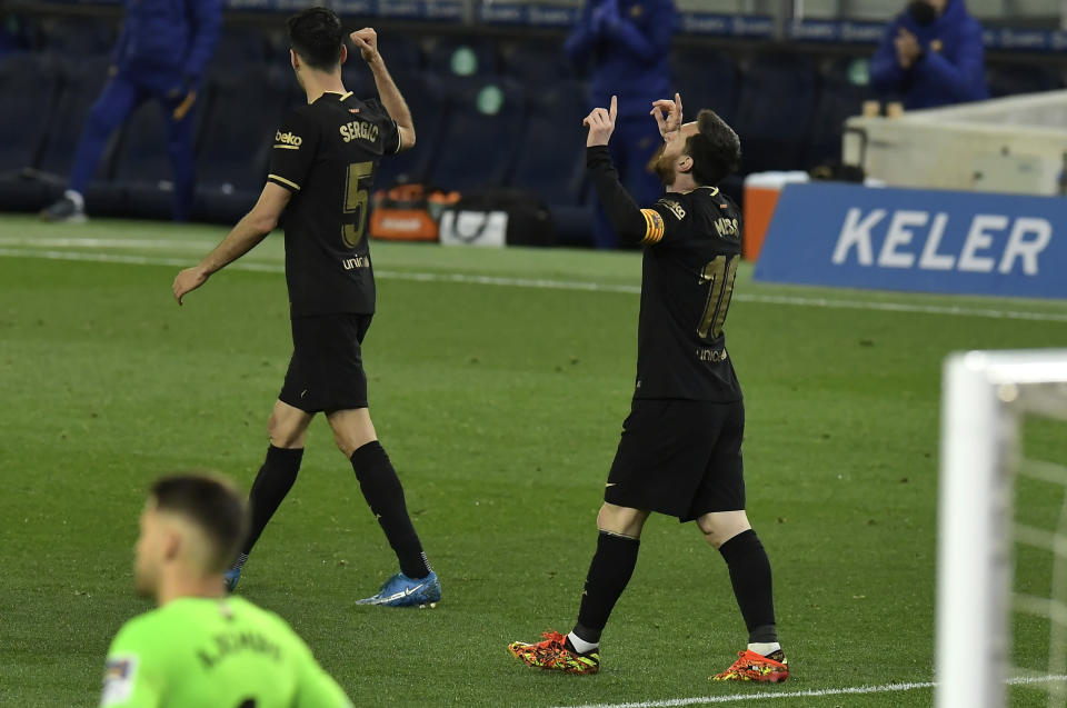 Barcelona's Lionel Messi celebrates scoring his side's 4th goal during the Spanish La Liga soccer match between Real Sociedad and FC Barcelona at Reale Arena stadium in San Sebastian, Spain, Sunday, March. 21, 2021. (AP Photo/Alvaro Barrientos)