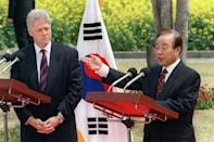 Then South Korean President Kim Young-Sam (R) adresses a press conference with then US President Bill Clinton (L) in the garden of the Shilla Hotel in Cheju Island on April 16, 1996