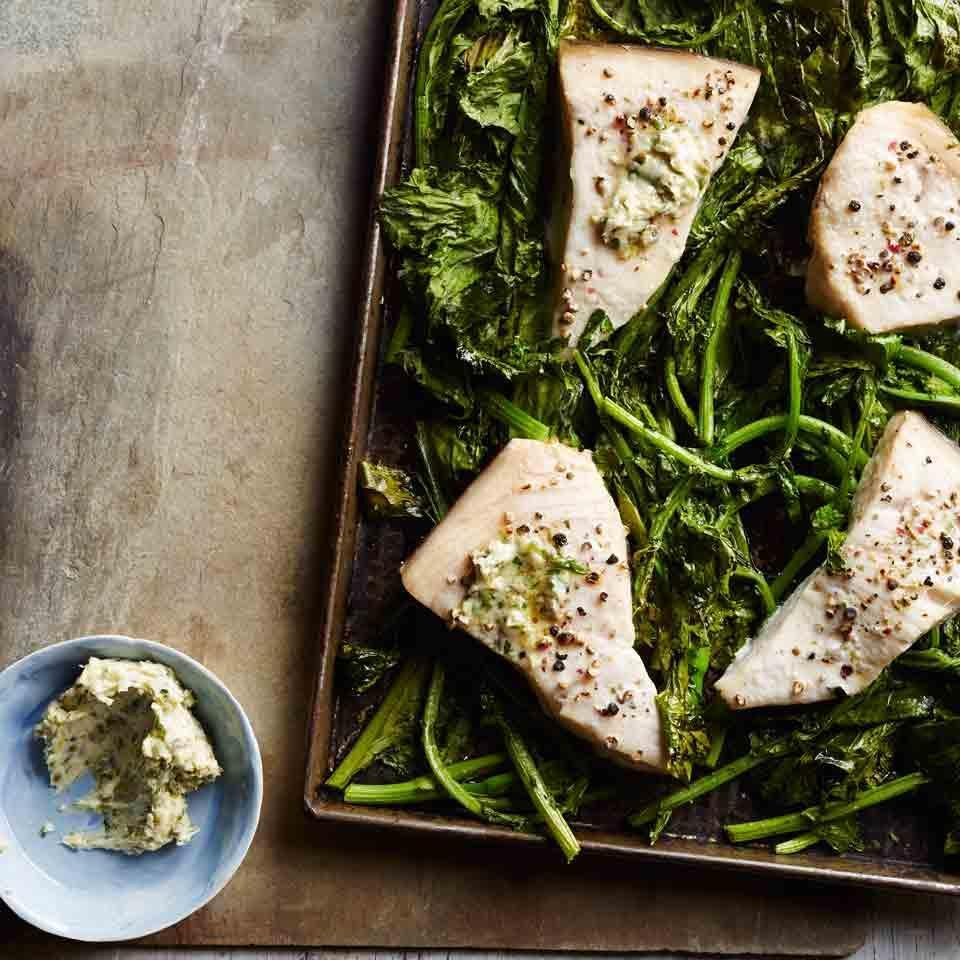 """<p>A compound butter made with capers, lemon, garlic and parsley punches up this quick and healthy fish dinner recipe. <a href=""""http://www.eatingwell.com/recipe/256502/roasted-swordfish-broccoli-rabe-with-piccata-butter/"""" rel=""""nofollow noopener"""" target=""""_blank"""" data-ylk=""""slk:View recipe"""" class=""""link rapid-noclick-resp""""> View recipe </a></p>"""