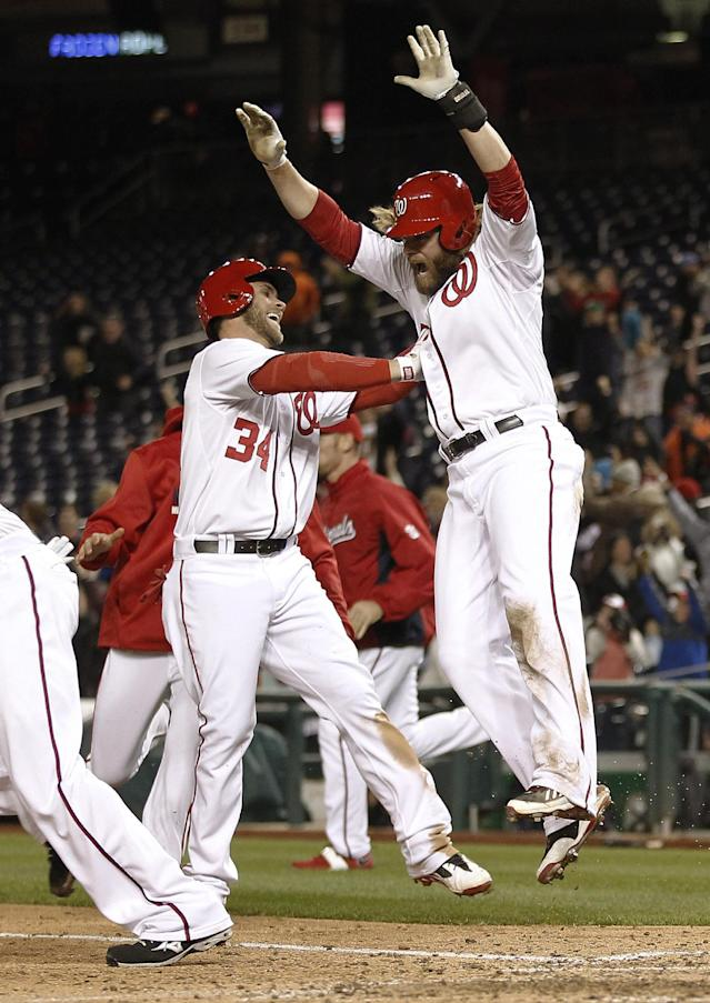 Washington Nationals Jayson Werth, right, celebrates with Bryce Harper (34) after scoring the winning run on a hit by Adam LaRoche during the ninth inning of a baseball game against the Los Angeles Angels, Wednesday, April 23, 2014 in Washington. The Nationals won 5-4. (AP Photo/Pablo Martinez Monsivais)