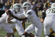 Colorado State quarterback Todd Centeio (7) hands off the ball during the first quarter of an NCAA college football game against Iowa, Saturday, Sept. 25, 2021, in Iowa City, Iowa. (AP Photo/Ron Johnson)