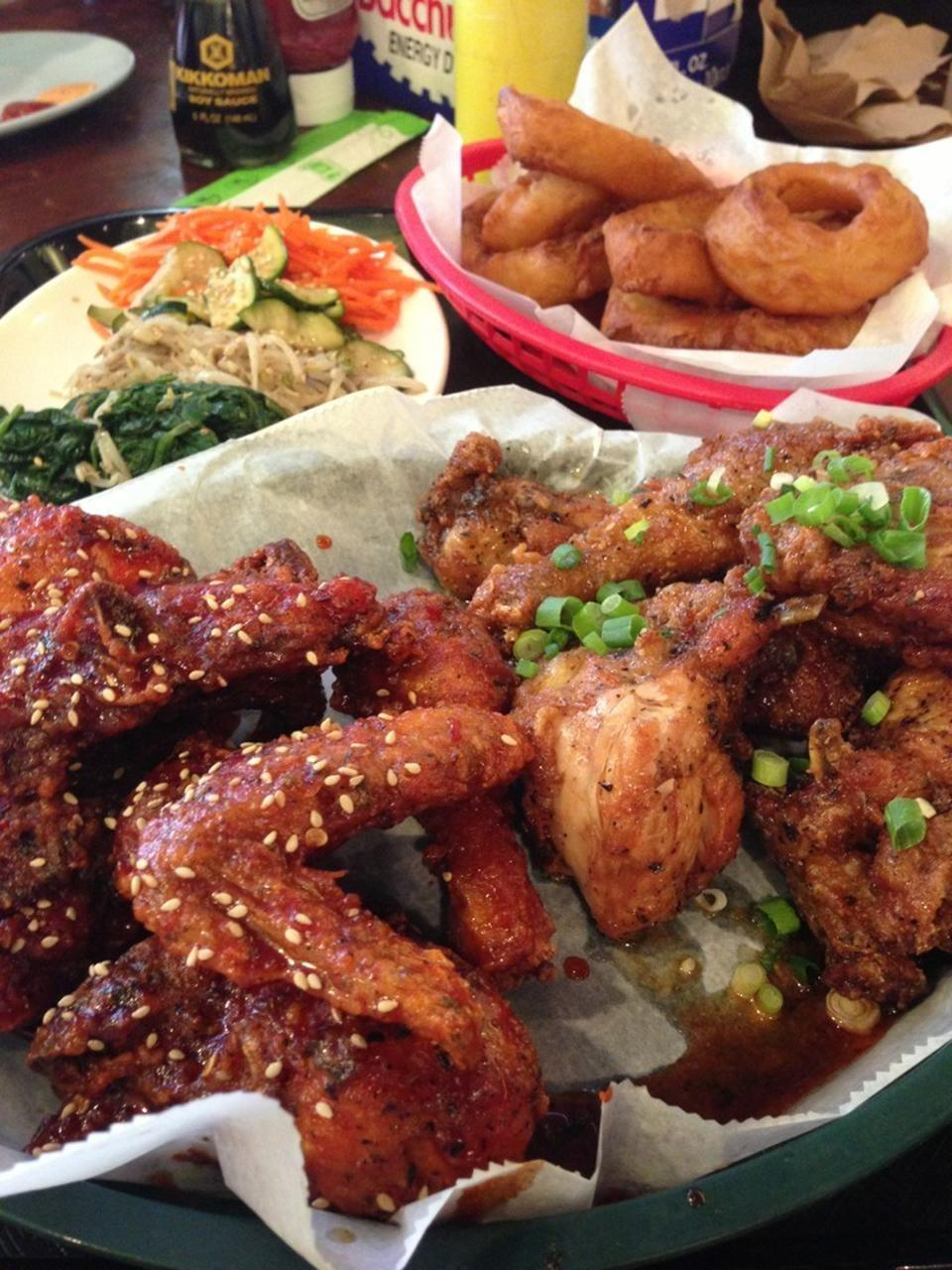 """<p><a href=""""https://www.tripadvisor.com/Restaurant_Review-g35805-d1220248-Reviews-Crisp-Chicago_Illinois.html"""" rel=""""nofollow noopener"""" target=""""_blank"""" data-ylk=""""slk:Crisp"""" class=""""link rapid-noclick-resp"""">Crisp</a>, Chicago</p><p>The Seoul Sassy fried chicken is undeniably amazing. It's twice-fried in a pressure cooker, and drizzled with a soy, <span class=""""entity tip_taste_match"""">garlic</span>, and <span class=""""entity tip_taste_match"""">ginger</span> <span class=""""entity tip_taste_match"""">marinade</span> and tossed with crunchy <span class=""""entity tip_taste_match"""">scallions</span>.<span class=""""redactor-invisible-space""""> - Foursquare user <a href=""""https://foursquare.com/redeyechicago"""" rel=""""nofollow noopener"""" target=""""_blank"""" data-ylk=""""slk:Redeye Chicago"""" class=""""link rapid-noclick-resp"""">Redeye Chicago</a></span><br></p>"""