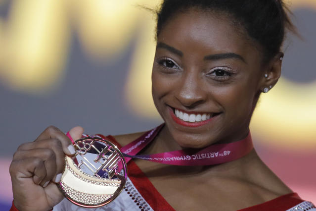 "<a class=""link rapid-noclick-resp"" href=""/olympics/rio-2016/a/1112764/"" data-ylk=""slk:Simone Biles"">Simone Biles</a> won her first gold in vault at the world competition and broke an all-time record. (AP)"