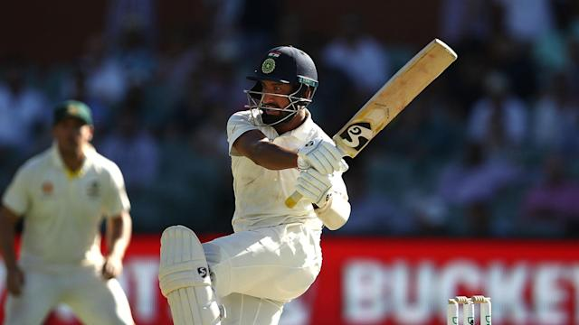 Usman Khawaja's sensational catch headlined a good start for Australia, but Cheteshwar Pujara rescued India with a fine century on day one.