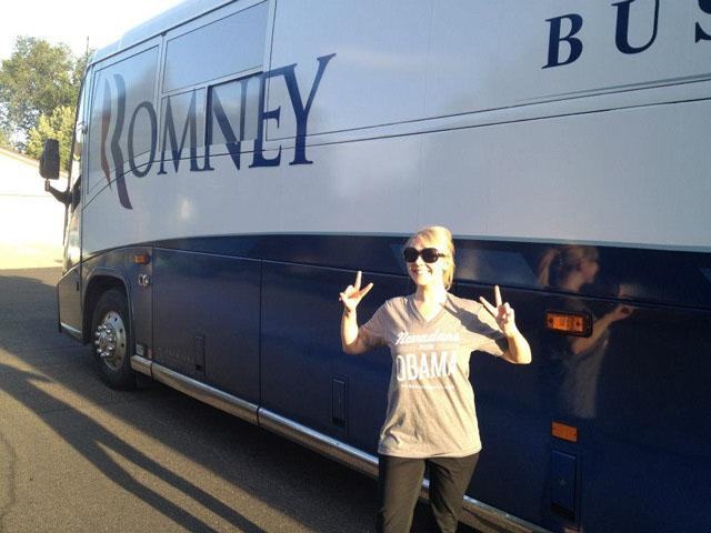 Obama supporter Katie Silva poses in front of Romney's campaign bus in Reno, Nev. (Katie Silva)