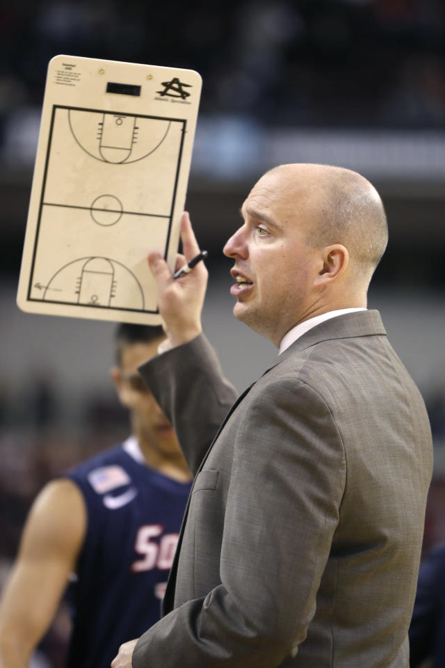 South Alabama coach Matthew Graves talks to his players in the second half of an NCAA college basketball game against Arkansas in North Little Rock, Ark., Saturday, Dec. 21, 2013. Arkansas defeated South Alabama 72-60. (AP Photo/Danny Johnston)