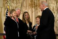 <p>Then U.S. Secretary of State Hillary Clinton is sworn in by Biden as her husband, former President Bill Clinton, her daughter, Chelsea, and her mother Dorothy Rodham look on in February 2009. </p>