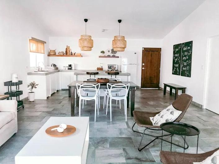 """<p><strong>Cabo San Lucas, Mexico</strong></p> <p>Boho chic immediately comes to mind when you look upon this Baja-based home, located just minutes away from Medano Beach. The minimalist design of the home, coupled with the earth-tone decor, gives a beach vibe feeling all throughout the living room, dining room, and bedrooms. Catch a cool breeze with your pooch on the patio inside the tranquil <a href=""""https://www.architecturaldigest.com/gallery/best-hammocks?mbid=synd_yahoo_rss"""" rel=""""nofollow noopener"""" target=""""_blank"""" data-ylk=""""slk:hammock"""" class=""""link rapid-noclick-resp"""">hammock</a>.</p> $130, Airbnb. <a href=""""https://www.airbnb.com/rooms/43834733"""" rel=""""nofollow noopener"""" target=""""_blank"""" data-ylk=""""slk:Get it now!"""" class=""""link rapid-noclick-resp"""">Get it now!</a>"""