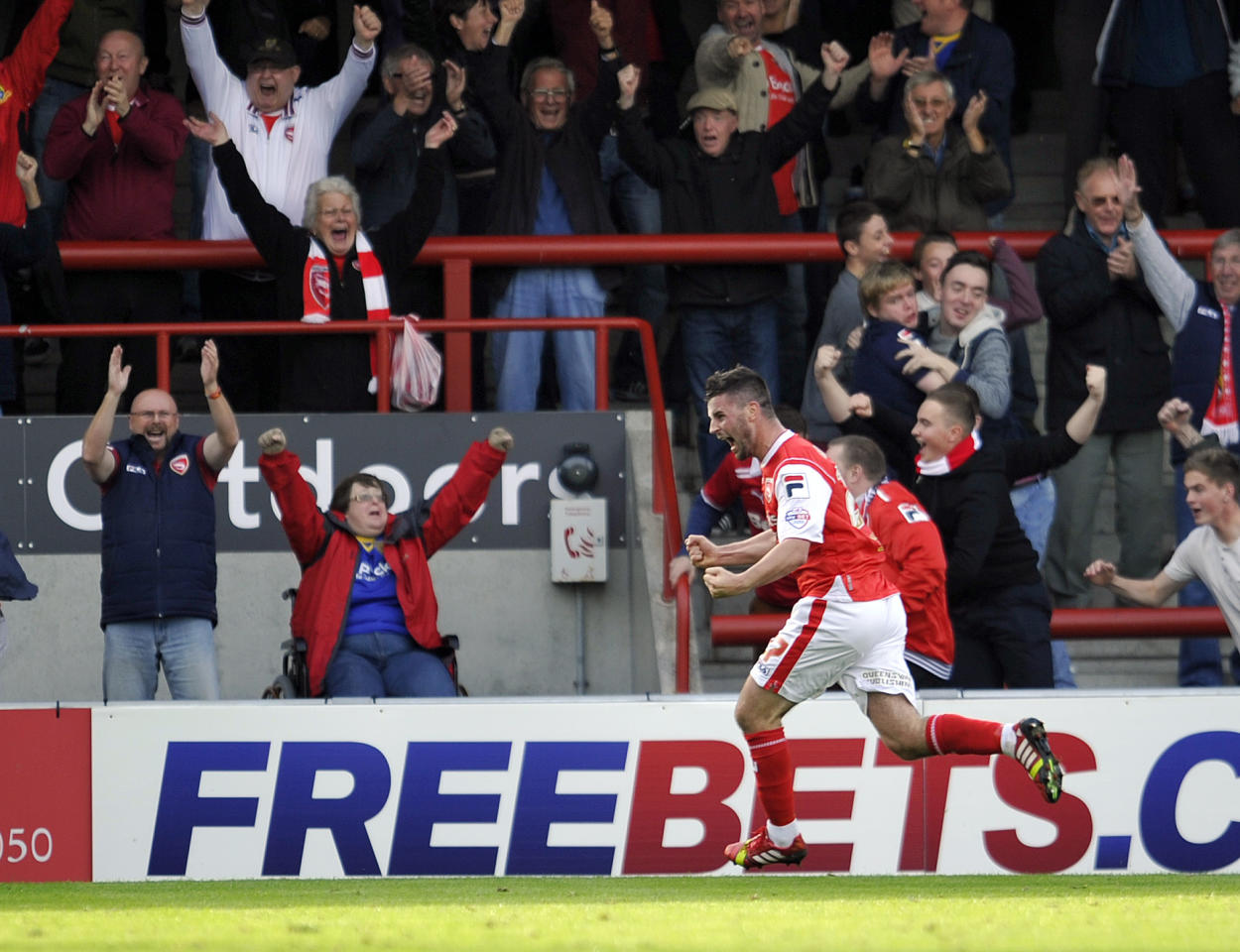 Morecambe's Padraig Amond celebrates after he scores the fourth goal of the game for his side during the Sky Bet League Two match at Globe Arena, Morecambe.