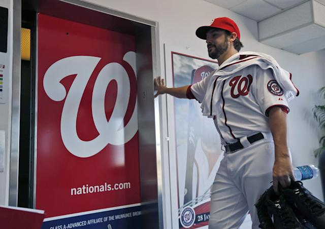Washington Nationals pitcher Tanner Roark pauses before entering the elevator at their spring training baseball facility, Thursday, Feb. 13, 2014, in VIera, Fla. (AP Photo/Alex Brandon)