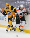 Pittsburgh Penguins' Cody Ceci (4) and Philadelphia Flyers' Jakub Voracek chase the puck during the second period of an NHL hockey game Thursday, March 4, 2021, in Pittsburgh. (AP Photo/Keith Srakocic)