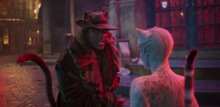 """This image released by Universal Pictures shows Idris Elba as Macavity, left, and Francesca Hayward as Victoria in a scene from """"Cats."""" (Universal Pictures via AP)"""