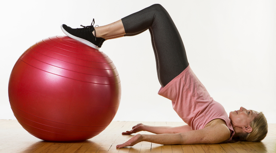 Glute bridges can help with back pain. (Photo: Canva)