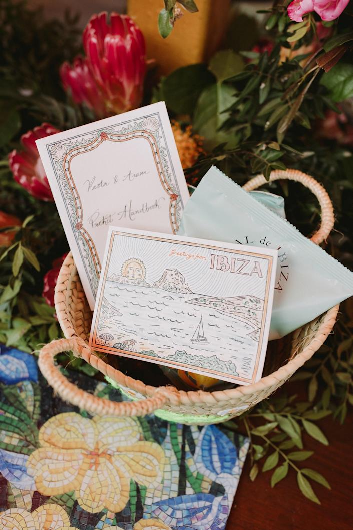 """These were the welcome bags that we gave our guests the first evening. They were baskets with daisies and """"Ibiza"""" written across them. They had the essentials: our guide to Ibiza, a bottle of my Nonno's secret limoncello recipe, Sal de Ibiza chips, and a postcard by Fee Greening so people could write home about exploring Ibiza."""