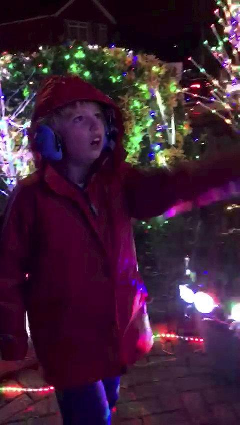 Incredible moment a non verbal nine-year-old said his first words - when he read out 'ho ho ho' spelled out by a Christmas light display