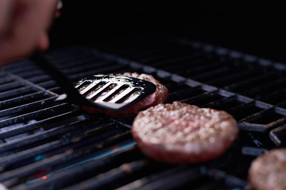 """<p>""""The constant poking and prodding of burgers releases the delicious juices that make them, well, juicy,"""" Melissa Knific, chef and recipe developer at <a href=""""http://hellofresh.com/"""" rel=""""nofollow noopener"""" target=""""_blank"""" data-ylk=""""slk:HelloFresh"""" class=""""link rapid-noclick-resp"""">HelloFresh</a>, explains to Woman's Day. """"And that means you're compromising flavor."""" </p><p>So keep the spatula at a distance until you're ready to flip. </p>"""
