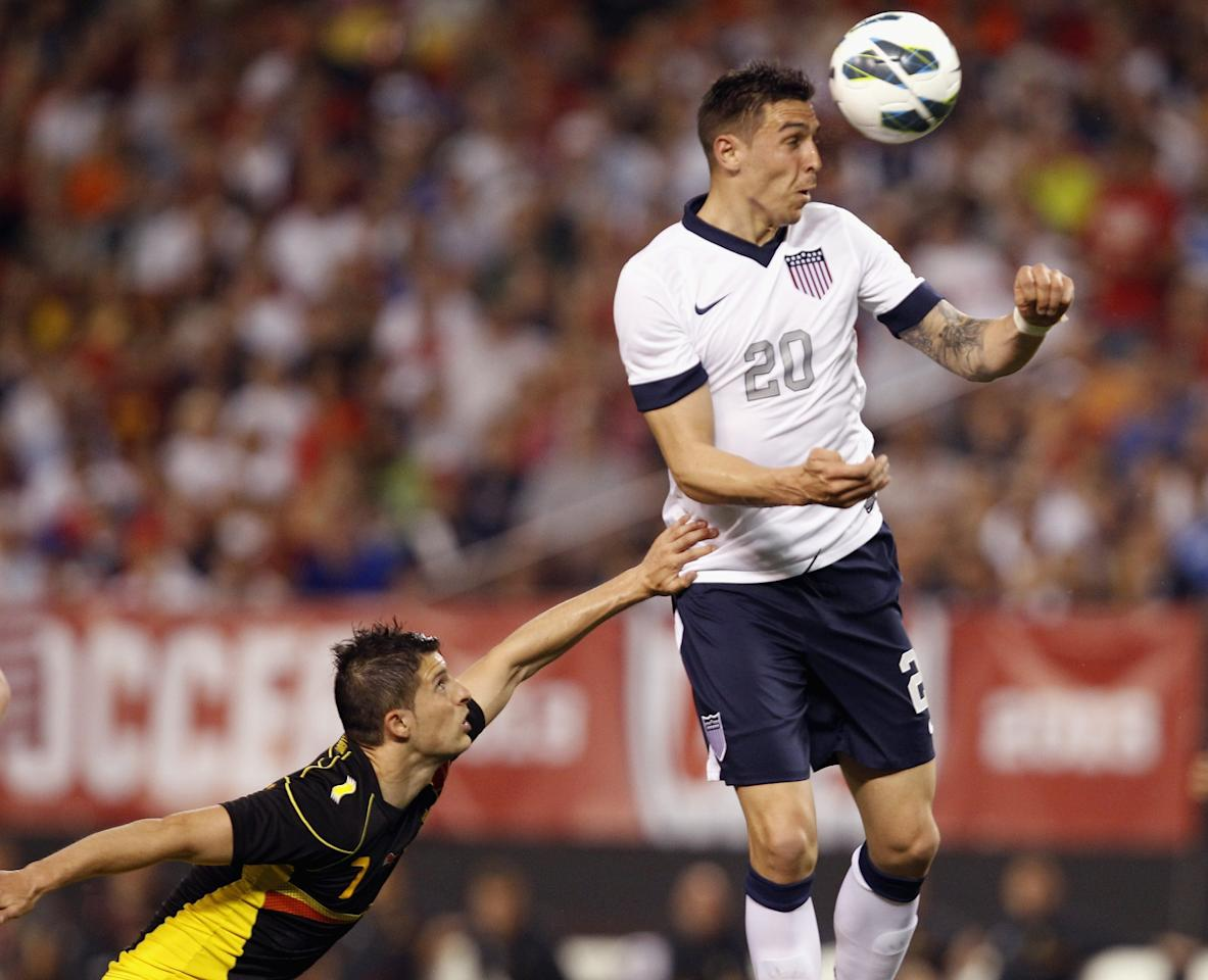 CLEVELAND, OH - MAY 29:  Geoff Cameron #20 of the U.S. Mens National Team jumps for a header over Kevin Mirallas #7 of Belgium during their International Friendly match at FirstEnergy Stadium on May 29, 2013 in Cleveland, Ohio.  (Photo by Matt Sullivan/Getty Images)