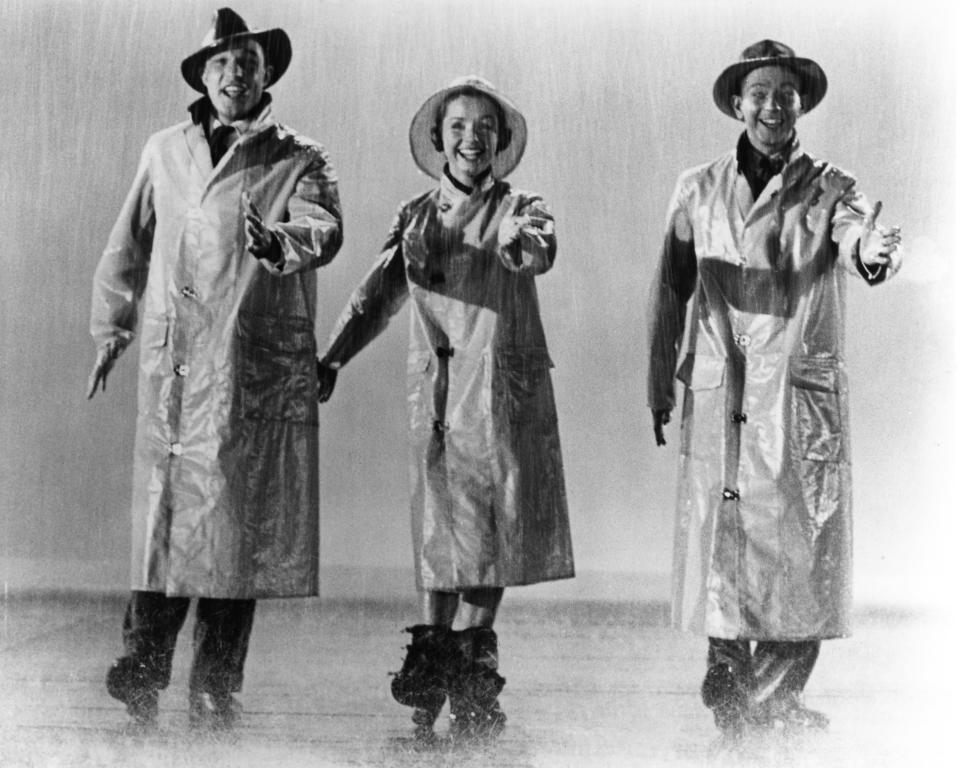 From left to right, actors and singers Gene Kelly, Debbie Reynolds and Donald O'Connor in the musical film 'Singin' in the Rain', 1952. (Photo by Silver Screen Collection/Getty Images)