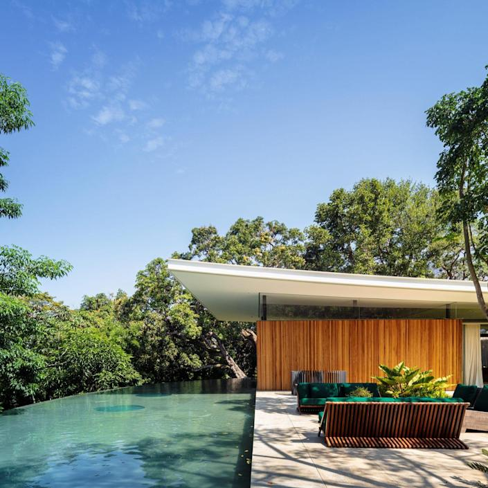 A lavish swimming pool sits to one side of the main Asa House volume.
