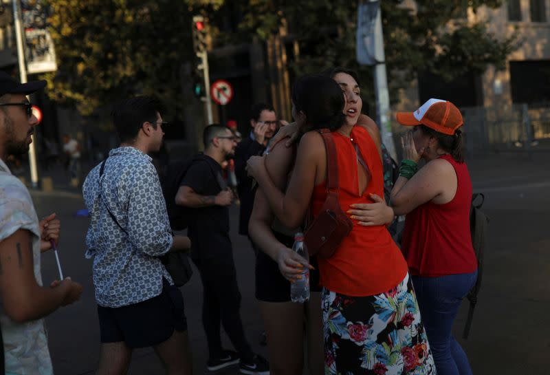 Chilean Emilia Schneider, a transgender woman, student and political activist, greets friends and fellow activists, in Santiago