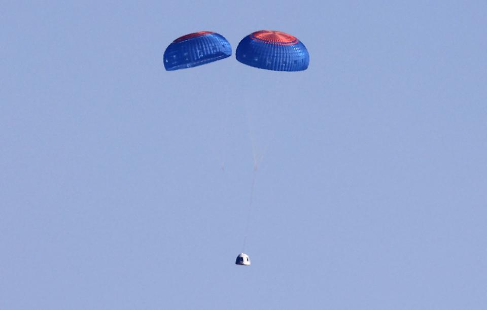 VAN HORN, TEXAS - OCTOBER 13: Blue Origin's New Shepard crew capsule descends on the end of its parachute system carrying 90-year-old Star Trek actor William Shatner and three other civilians after their flight on October 13, 2021 near Van Horn, Texas. Shatner became the oldest person to fly into space on the ten minute flight. Shatner, along with civilians Audrey Powers, Chris Boshuizen and Glen de Vries, are riding aboard mission NS-18, the second human spaceflight for the company which is owned by Amazon founder Jeff Bezos. (Photo by Mario Tama/Getty Images)