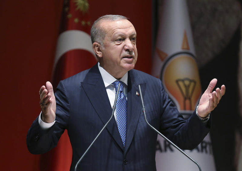 """Turkey's President Recep Tayyip Erdogan addresses his ruling party members, in Ankara, Turkey, Friday, July 26, 2019. Erdogan says Turkey is determined to destroy what he called a """"terror corridor"""" in northern Syrian regardless of whether or not Turkey and the United States agree on the establishment of a safe zone. Turkish and U.S. officials have been holding talks for a safe zone east of the river Euphrates to address Turkey's security concerns.(Presidential Press Service via AP, Pool)"""