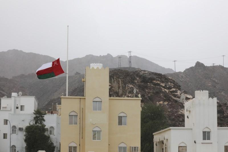 FILE PHOTO: Oman's national flag flies at half mast after the death of Oman's Sultan Qaboos bin Said was announced in Muscat