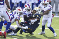 Los Angeles Chargers running back Austin Ekeler (30) is tackled by Buffalo Bills strong safety Micah Hyde (23) and cornerback Levi Wallace (39) during the first half of an NFL football game, Sunday, Nov. 29, 2020, in Orchard Park, N.Y. (AP Photo/Adrian Kraus)