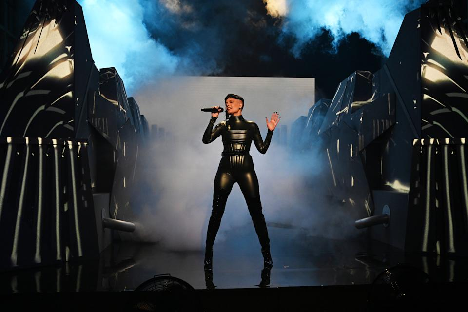Halsey in a black catsuit performing on Saturday Night Live.