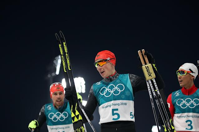 Nordic Combined Events – Pyeongchang 2018 Winter Olympics – Men's Individual 10km Final – Alpensia Cross-Country Skiing Centre - Pyeongchang, South Korea – February 14, 2018 - Johannes Rydzek of Germany, Eric Frenzel of Germany and Akito Watabe of Japan after the finish line. REUTERS/Carlos Barria