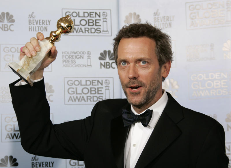 """FILE - In this Jan. 15, 2007 file photo, actor Hugh Laurie poses with the award he won for best actor in a drama series for his work on """"House,"""" at the 64th Annual Golden Globe Awards in Beverly Hills, Calif. The Fox medical drama concludes its eight-season run on Monday, May 21, 2012, with a finale at 9 p.m. EDT, preceded by a one-hour retrospective. (AP Photo/Kevork Djansezian, file)"""
