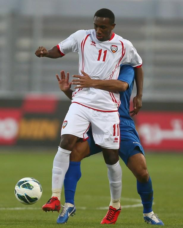 Ahmad Khalil Omar Abelahman (front) of United Arab Emirates vies for the ball against Husain al-Shammari of Kuwait during the two teams' semi-final match in the 21st Gulf Cup in Manama, on January 15, 2013. AFP PHOTO/MARWAN NAAMANI