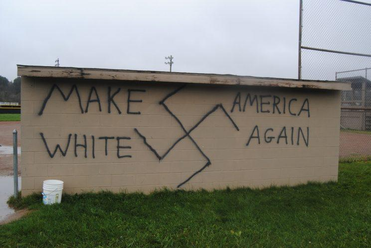 """A swastika was graffitied with the words """"Make America White Again"""" on a softball dugout wall in Wellsville, New York. (Photo: Brian Quinn via Twitter)"""