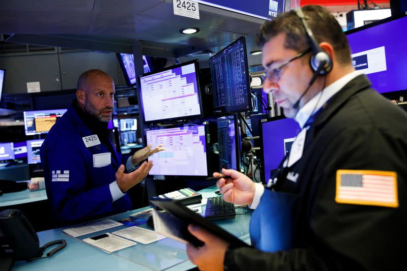 Traders work on the floor of the New York Stock Exchange (NYSE) in New York City