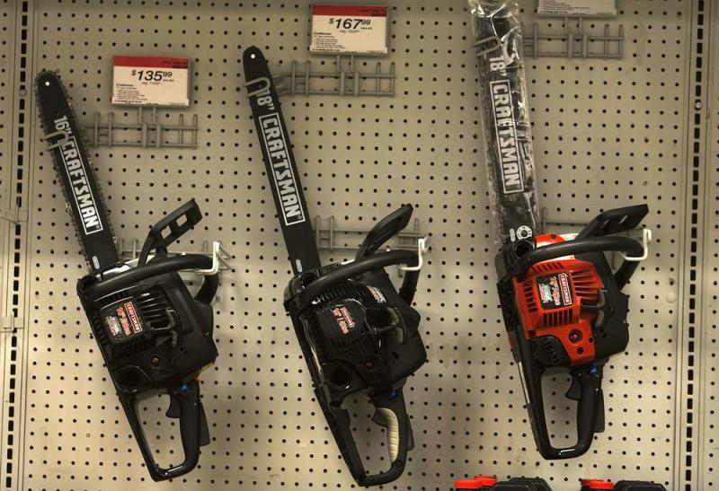 Sears Brand Craftsman chainsaws are displayed for sale.