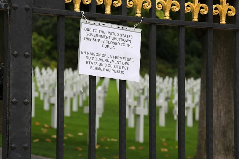 A notice advising visitors that the American Cemetery is closed due to the partial shutdown of the U.S. federal government hangs from the gates of the cemetery in Suresnes, west of Paris, Tuesday Oct. 1, 2013. The U.S. plunged into a partial government shutdown for the first time in nearly two decades because of a budget impasse in Congress, closing public sites in the U.S. and abroad. (AP Photo/Remy de la Mauviniere)