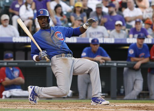 Chicago Cubs' Junior Lake falls out of the batter's box to avoid an inside pitch against the Colorado Rockies in the fourth inning of a baseball game in Denver on Saturday, July 20, 2013, in Denver. (AP Photo/David Zalubowski)