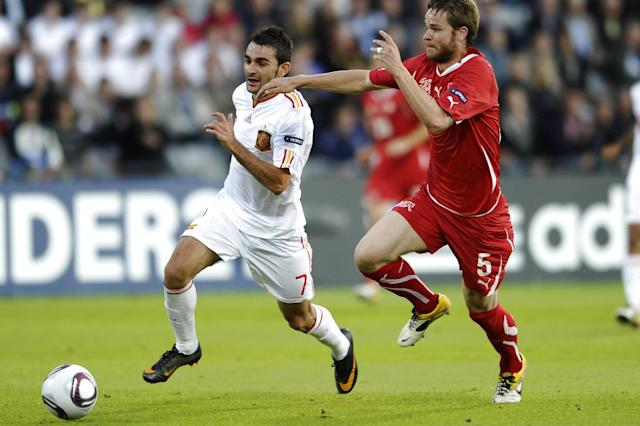 Adrian Lopez of Spain (L) vies for the ball against Fbian Lustenberger of Switzerland during the UEFA Under-21 European Championship final football match at NRGI Park Stadium in Arhus Stadion Denmark June 25, 2011. AFP HENNING BAGGER/SCANPIX (Photo credit should read HENNING BAGGER/AFP/Getty Images)
