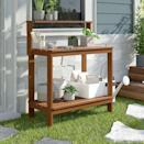 """<p><strong>Sol 72 Outdoor</strong></p><p>wayfair.com</p><p><strong>$144.90</strong></p><p><a href=""""https://go.redirectingat.com?id=74968X1596630&url=https%3A%2F%2Fwww.wayfair.com%2Foutdoor%2Fpdp%2Fsol-72-outdoor-aanya-hardwood-dark-red-meranti-potting-bench-w000324725.html&sref=https%3A%2F%2Fwww.goodhousekeeping.com%2Fhome%2Fgardening%2Fadvice%2Fg495%2Fsmall-garden-ideas%2F"""" rel=""""nofollow noopener"""" target=""""_blank"""" data-ylk=""""slk:Shop Now"""" class=""""link rapid-noclick-resp"""">Shop Now</a></p><p>With a roomy shelf underneath, this wood piece doubles as a mini garden """"shed"""" for storage. </p>"""